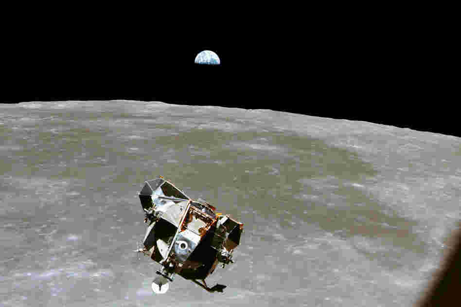 With a half-Earth in the background, the lunar module, in its ascent stage with moon-walking Armstrong and Aldrin, approaches for a rendezvous with the Apollo command module, manned by Collins.