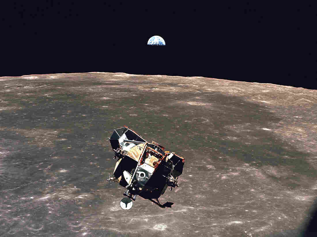 The Earth rises behind the Apollo 11 lunar module during its return flight from the Moon's surface. The audacity of what can be done far way sometimes puts earthly challenges in perspective.