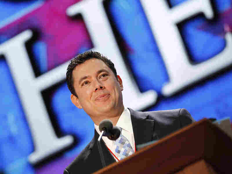 Utah Rep. Jason Chaffetz stands on the stage Saturday during preparation for the convention.