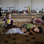 Syrian children, who fled their home with their family, take refuge at the Bab Al-Salameh border crossing, in hopes of entering one of the refugee camps in Turkey on Sunday.