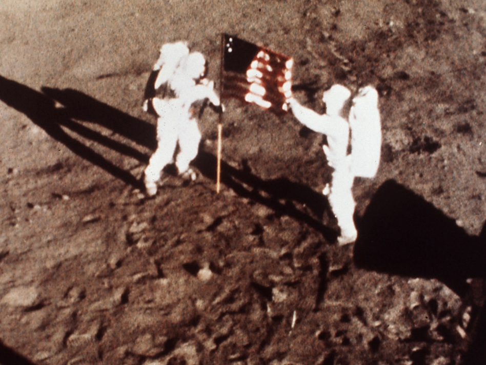 """On July 20, 1969, Apollo 11 astronauts Neil Armstrong and Edwin E. """"Buzz"""" Aldrin, the first men to land on the moon, plant the U.S. flag on the lunar surface. (AP/NASA)"""