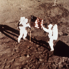 "On July 20, 1969, Apollo 11 astronauts Neil Armstrong and Edwin E. ""Buzz"" Aldrin, the first men to land on the moon, plant the U.S. flag on the lunar surface."