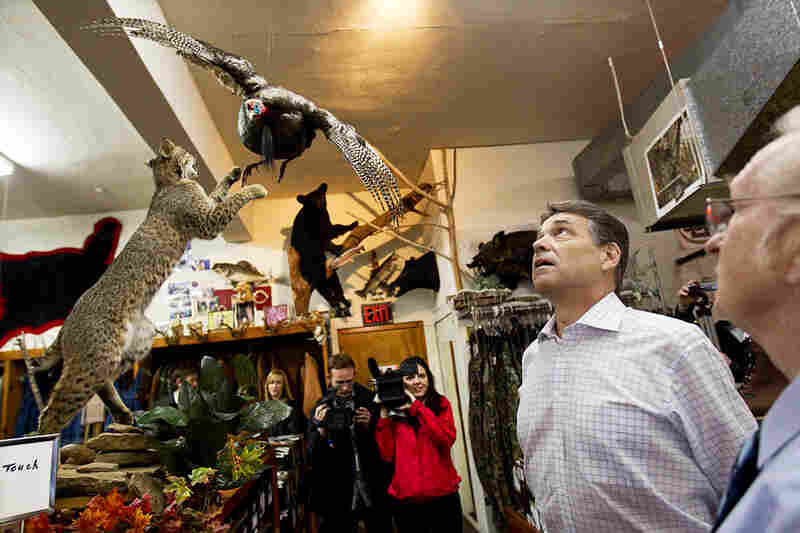 Texas Gov. Rick Perry, who played up a folksy image during his short-lived run for the GOP nomination, stopped at a hunting display at Brock's department store in Pickens, S.C., in January.