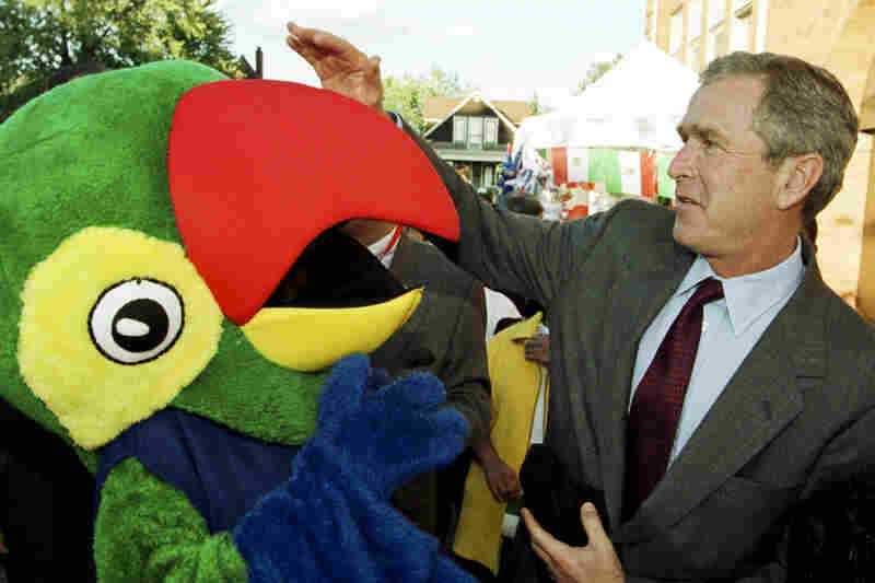 During his first bid for the White House, then-Texas Gov. George W. Bush joked around with a person in a parrot costume at a Mexican independence festival in Detroit, Ill., in September 1999.