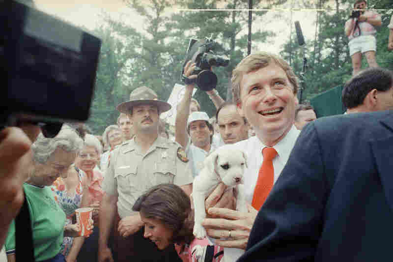 Republican vice presidential candidate Dan Quayle holds a puppy during a campaign appearance in Newnan, Ga., in 1988.