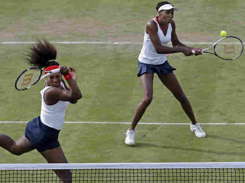 Serena Williams, left, and Venus Williams compete in Wimbledon at the 2012 Summer Olympics.