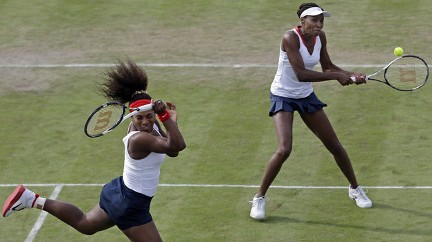 Serena Williams, left, and Venus Williams compete in Wimbledon at the 2012 Summer Olympics. (AP)