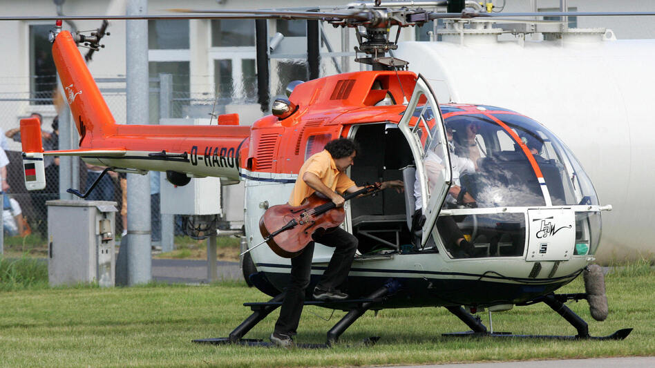 Cellist Karl Huros alights a helicopter for his 2007 performance in Stockhausen's Helicopter Quartet, taken from his opera cycle Light. (AFP/Getty Images)