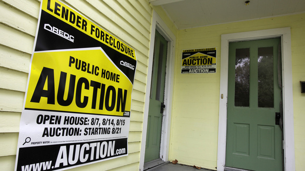 A home has a foreclosure auction sign displayed in Chagrin Falls, Ohio, in September 2010. (AP)