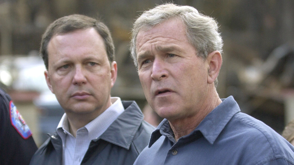 FEMA's Michael Brown (left) and President George W. Bush, seen in 2003, were widely criticized for their response after Hurricane Katrina devastated the Gulf Coast in 2005. (Getty Images)