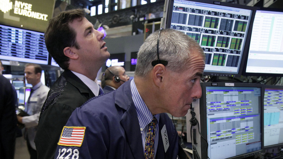 Traders work on the floor of the New York Stock Exchange. The Dow Jones industrial average is nearly back to where it was before the recession hit in 2007. (AP)