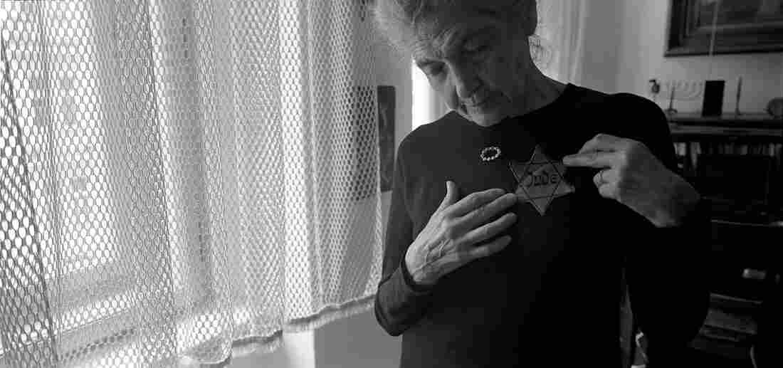 """Andula Lorencova, born in 1927, in her apartment with her original yellow star, Prague, June 2012. While her father was """"trying to procure official Chinese approval for his family to join him, Andula along with her brother and mother were deported to Terezin."""""""
