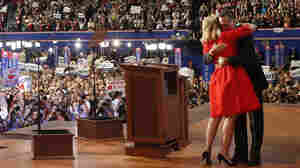 Ann Romney is hugged by her husband, Mitt, after she addressed delegates during the Republican National Convention in Tampa, Fla., on Tuesday.