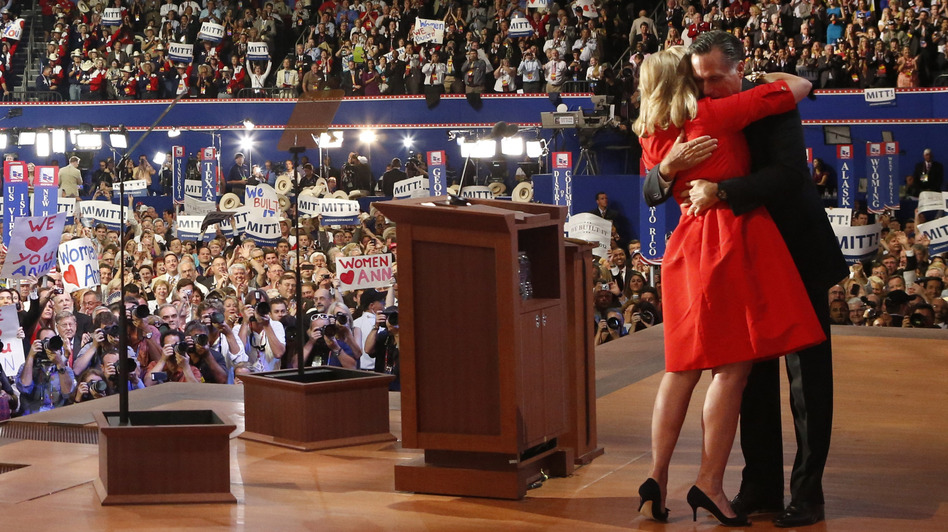 Ann Romney is hugged by her husband, Mitt, after she addressed delegates during the Republican National Convention in Tampa, Fla., on Tuesday. (Reuters/Landov)