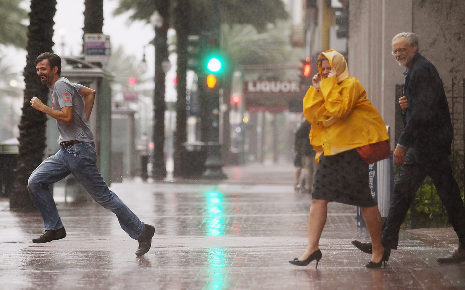 People make their way across Canal Street in New Orleans. Ed Rappaport, deputy director of the National Hurricane Center, said Isaac's core would pass west of the city and head for Baton Rouge. (Getty Images)