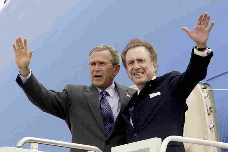 Specter campaigns with President George W. Bush in 2004 at the Harrisburg International Airport in Pennsylvania. Specter spent most of his political career as a moderate Republican. He supported Bush, but later criticized the then-president's warrantless wiretapping program, saying it overstepped civil liberties.