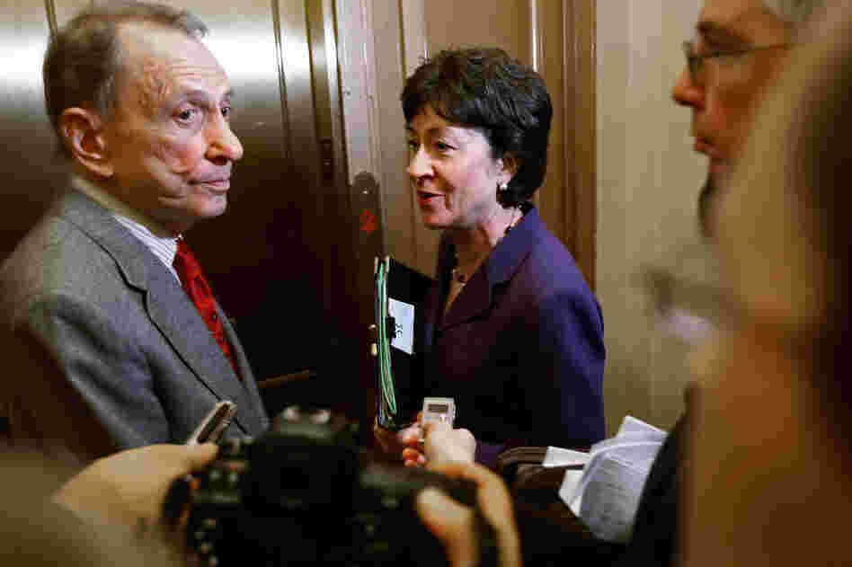 Specter and Sen. Susan Collins, R-Maine, board an elevator after a February 2009 meeting with Senate Majority Leader Harry Reid, D-Nev., to find a bipartisan compromise on the stimulus package. Specter and Collins were two of three Republicans who voted for the plan. Collins, like Specter, was considered to be one of a dwindling number of moderate Republicans.