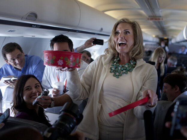 Ann Romney, wife of Republican presidential candidate Mitt Romney, shares her homemade Welsh cakes with reporters on the flight to Tampa on Tuesday.