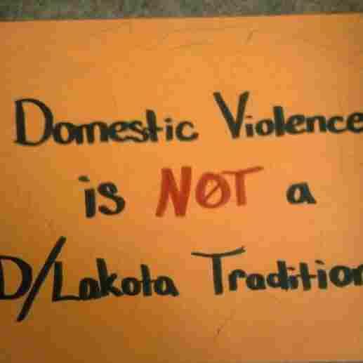 A handmade poster at Wiconi Wawokiya.