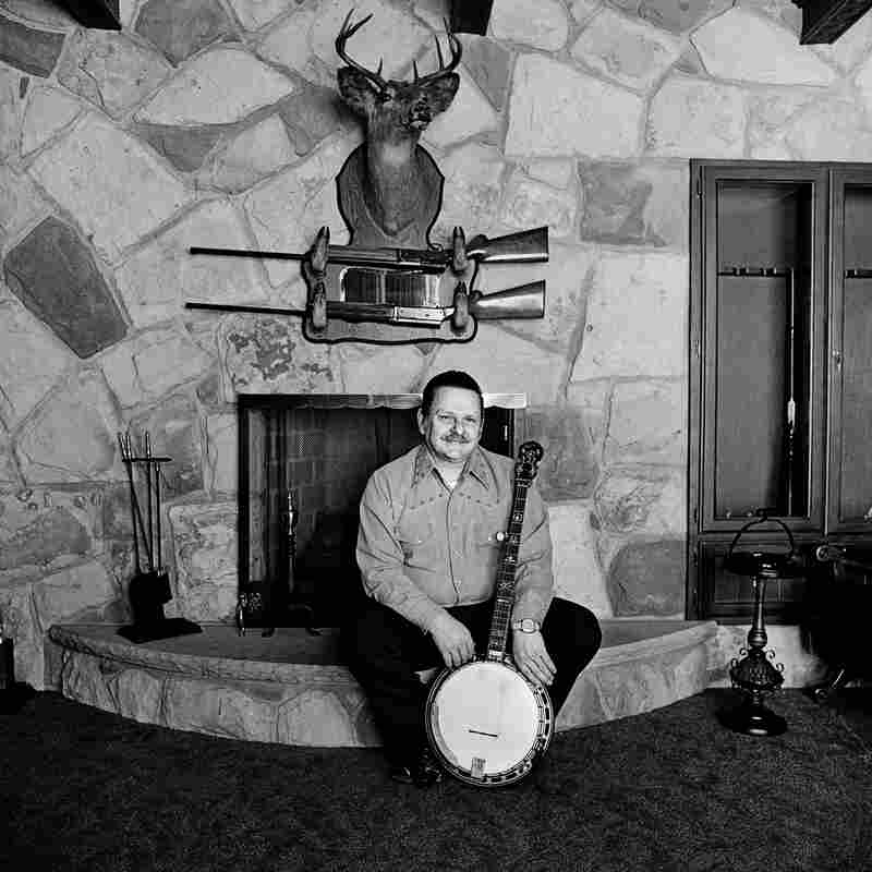 "Ralph Stanley at Home, Coeburn, Va., 1974. ""As bluegrass heroes go, Ralph Stanley is right up there with Bill Monroe. He began performing with brother Carter as the Stanley Brothers in 1946, and their old-time mountain sound has been hugely influential."""