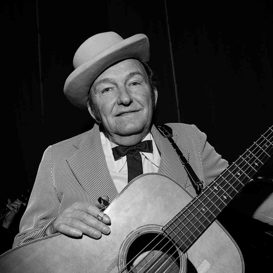 "Lester Flatt, Ryman Auditorium, Nashville, Tenn., 1972. ""Lester Flatt and banjoist Earl Scruggs were the successful Flatt and Scruggs. Flatt's contributions included strong baritone vocals and a signature guitar run, widely imitated even today."""