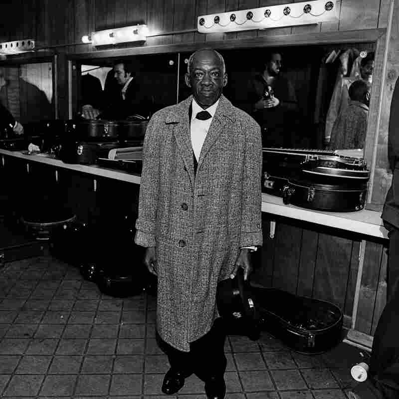 """DeFord Bailey, Grand Ole Opry House, Opryland, Nashville, Tenn., 1974. """"A member of the original Grand Ole Opry cast, DeFord Bailey was discovered in 1926 playing harmonica while operating an elevator. He was fired from the show in 1941 due to changing musical tastes or racism, depending on who's telling the story, and ran a shoeshine business in Nashville until just before his death."""""""