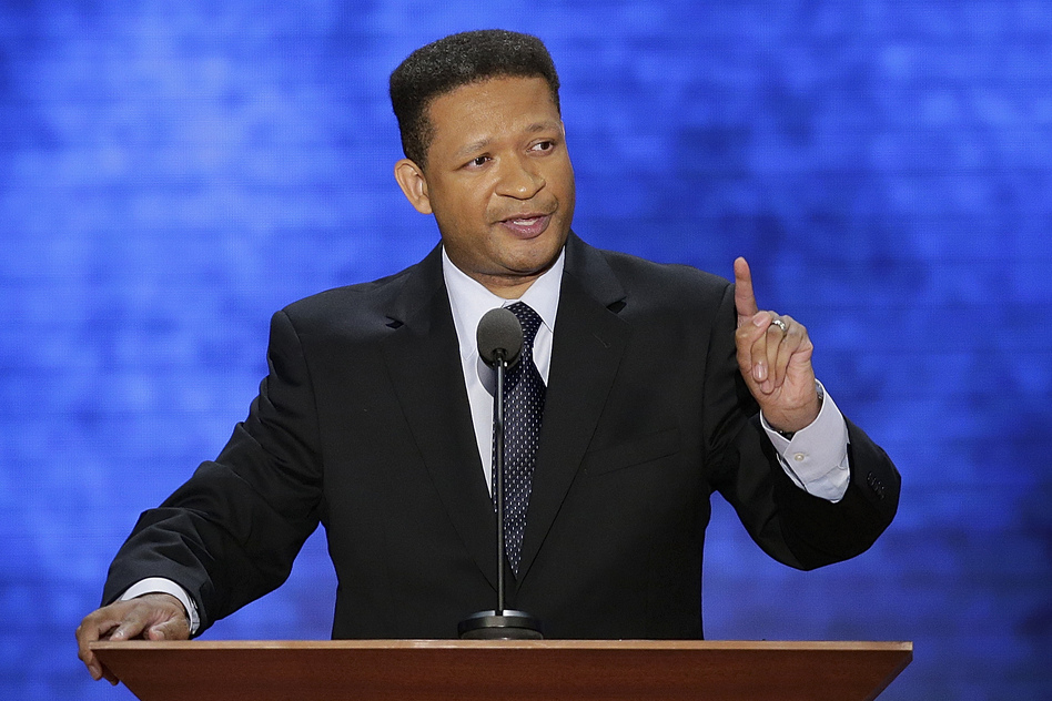 """Former Rep. Artur Davis addresses the crowd. Davis was until recently a Democratic congressmen. """"Some of you may know,"""" he said, """"the last time I spoke at a convention, it turned out I was in the wrong place."""" (AP)"""