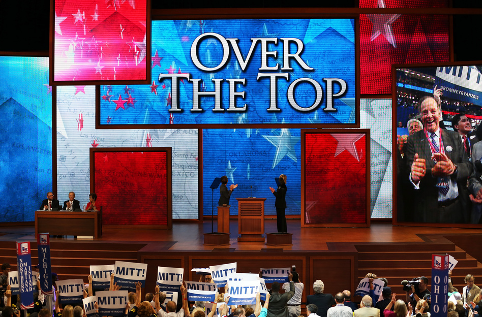 """People cheer during the roll call of states as delegates from New Jersey put Romney """"over the top,"""" giving him the official nod. It takes 1,144 delegates to become the nominee. (Getty Images)"""