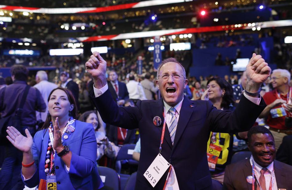 Ronna Romney McDaniel, Mitt Romney's niece, and Scott Romney, his brother, cheer at the convention. (AP)