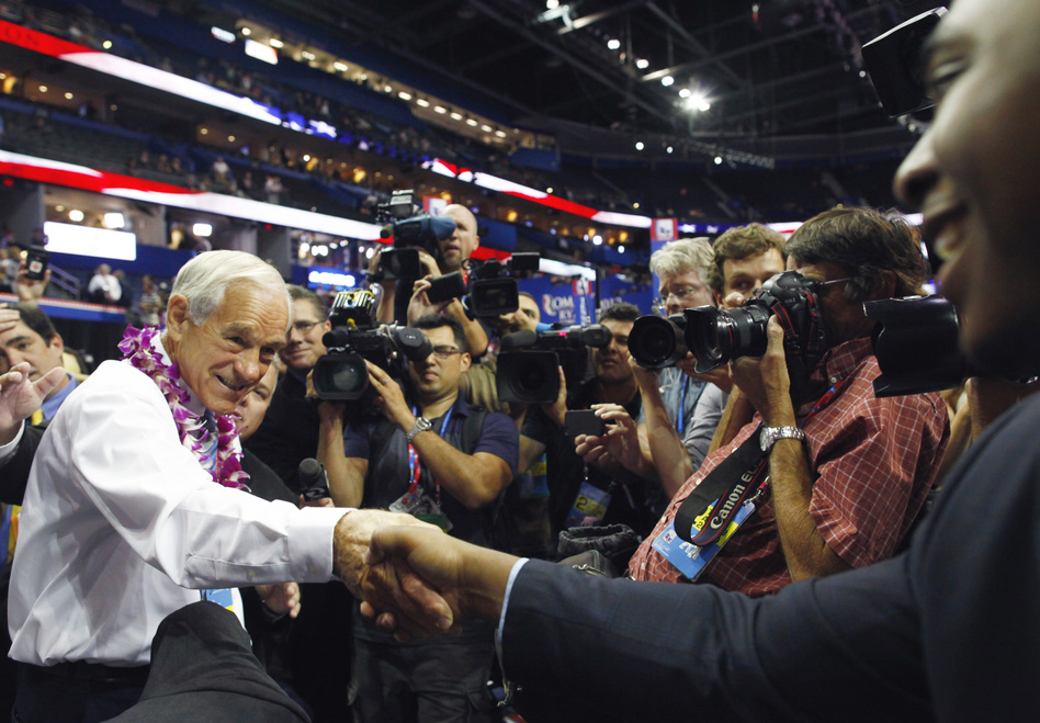 Texas Rep. Ron Paul greets convention goers. Paul supporters booed loudly and chanted against new rules adopted Tuesday that determine how delegates are apportioned in each state. (Reuters/Landov)