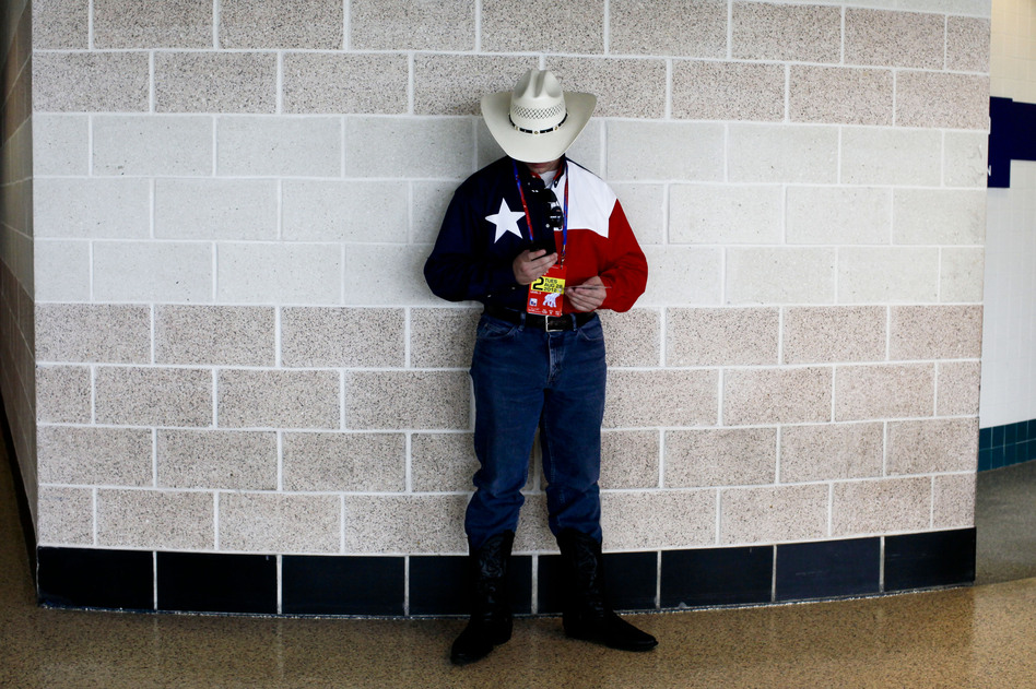 A delegate from Texas takes a break from the convention's festivities. Many of the delegates showed their hometown pride and patriotism through unique hats. (NPR)