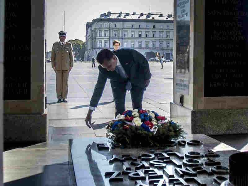 Republican presidential candidate, former Massachusetts Governor Mitt Romney, lays a wreath at the Tomb of the Unknown Soldier on July 31, 2012 in Warsaw, Poland.