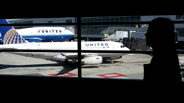 Two United Airlines planes sit at a terminal at San Francisco International Airport Friday. The airport briefly refused to accept any domestic arrivals Tuesday, after a computer crash disrupted United's system. (Getty Images)