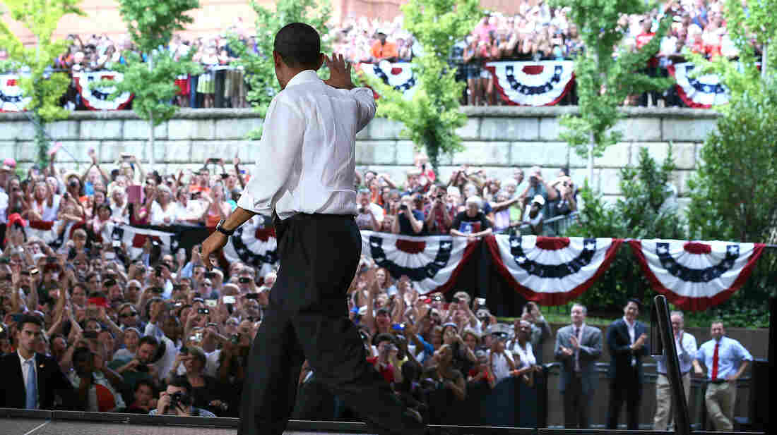 President Obama waves to supporters during a campaign stop Wednesday in Charlottesville, Va. He later participated in a question-and-answer session on Reddit.
