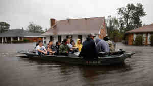 Rescue workers transport residents trapped by rising water from Hurricane Isaac in the River Forest subdivision on Wednesday in LaPlace, Louisiana. The large Level 1 hurricane slowly moved across southeast Louisiana, dumping huge amounts of rain and knocking out power across the Gulf Coast.