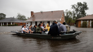 Rescue workers transport residents trapped by rising water from Hurricane Isaac in the River Forest subdivision on Wednesday in LaPlace, Louisiana. The large Level 1 hurricane slowly moved across southeast La., dumping huge amounts of rain and knocking out power across the Gulf Coast.