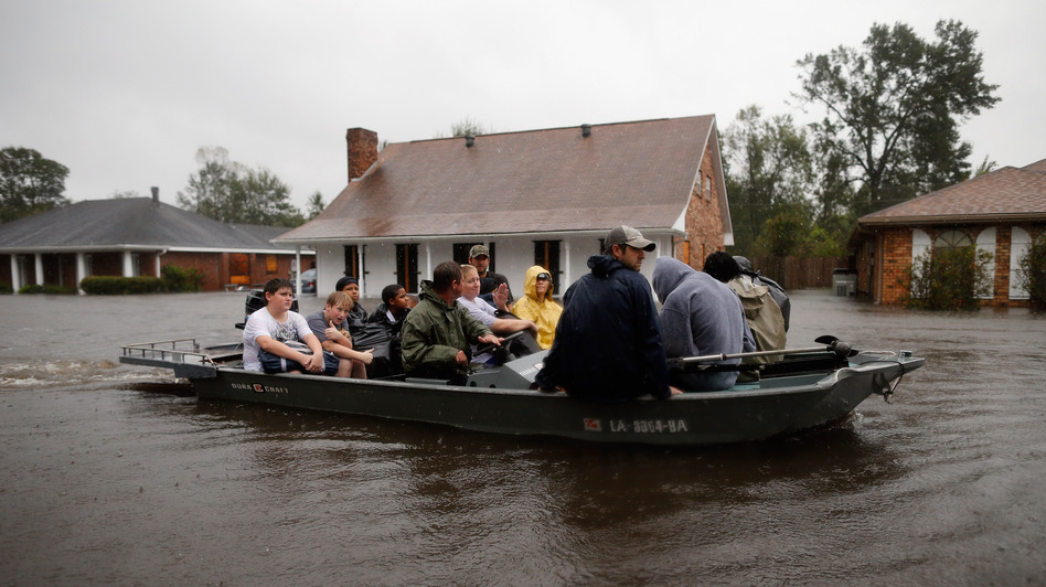 Rescue workers transport residents trapped by rising water from Hurricane Isaac in the River Forest subdivision on Wednesday in LaPlace, Louisiana. The large Level 1 hurricane slowly moved across southeast Louisiana, dumping huge amounts of rain and knocking out power across the Gulf Coast. (Getty Images)