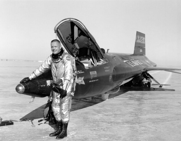 Neil Armstrong stands next to his X-15 rocket plane at Edwards Air Force Base in California.