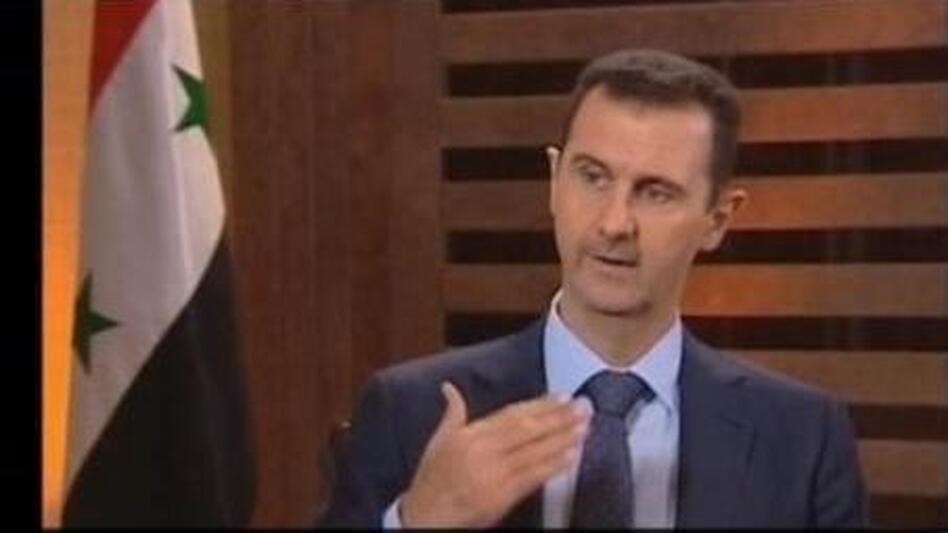 Screen grab from Syrian President Bashar Assad's televised interview. (Telegraph)