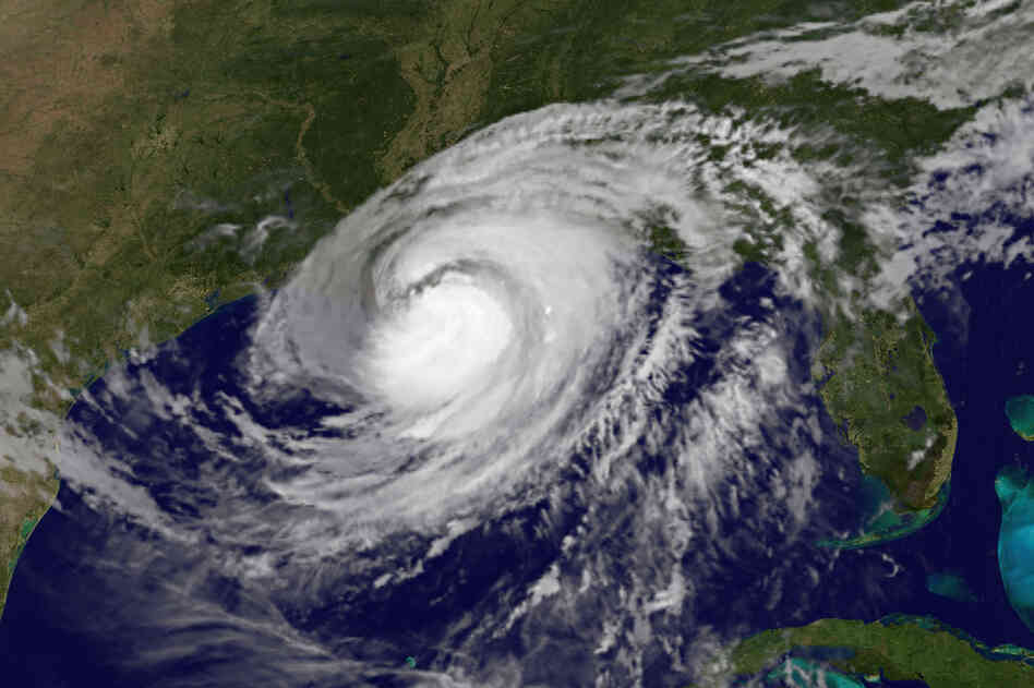 This satellite image shows Hurricane Isaac over the Gulf of Mexico and the Gulf states Wednesday. Rising waters spilled over a levee south of New Orleans and inundated a residential area that had been ordered evacuated.