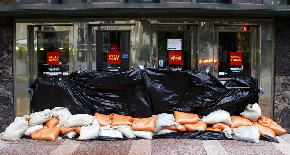 Sand bags block the entrance to a Wells Fargo bank in Mobile, Ala. (AP)