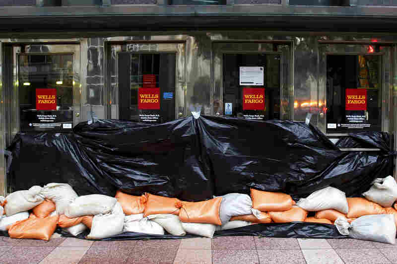 Sand bags block the entrance to a Wells Fargo bank in Mobile, Ala.
