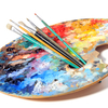 Artist's palette with brushes over white background