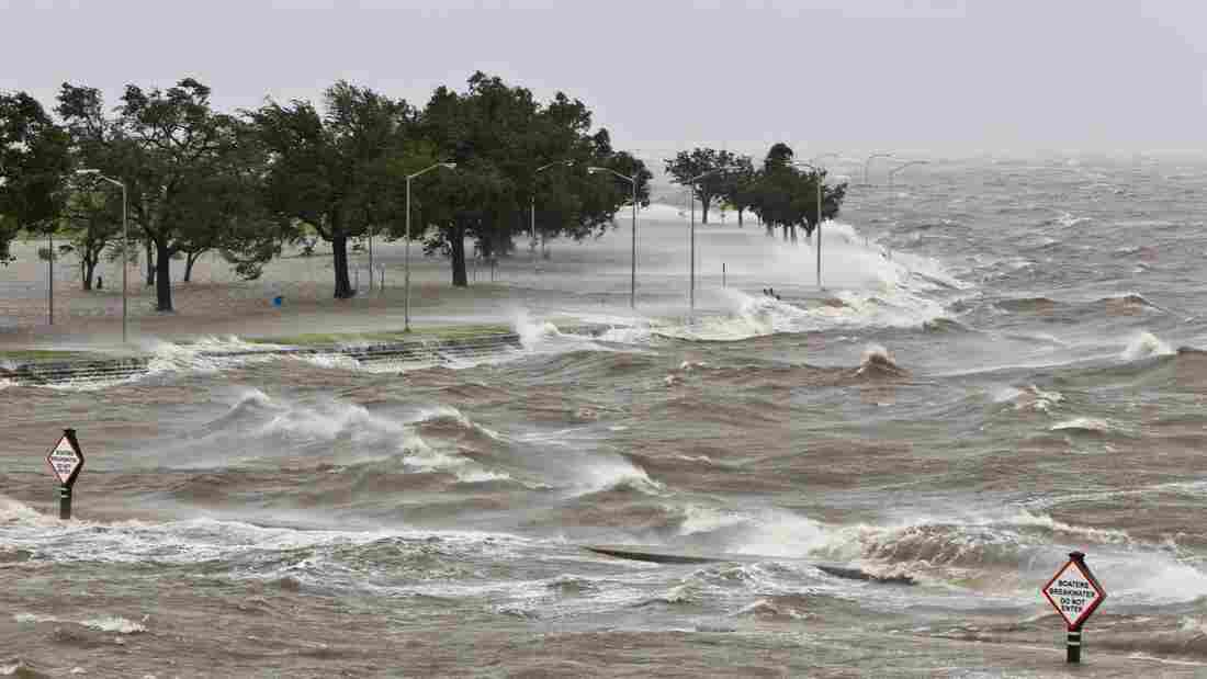 A storm surge causes tides to quickly rise while rough waves pound the concrete seawall along the shores of Lake Pontchartrain. Hurricane Isaac made landfall along the Gulf Coast and now threatens New Orleans.