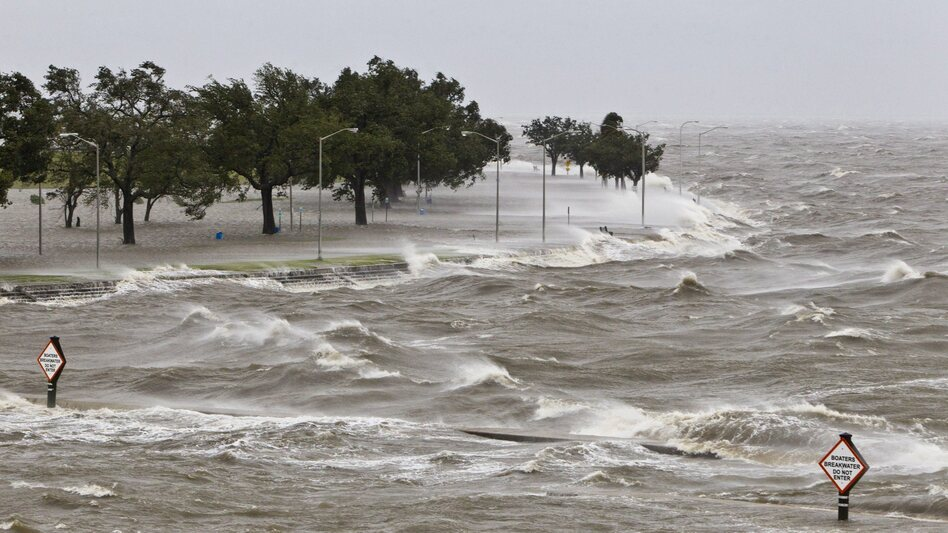 A storm surge causes tides to quickly rise while rough waves pound the concrete seawall along the shores of Lake Pontchartrain. Hurricane Isaac made landfall along the Gulf Coast and now threatens New Orleans. (EPA /Landov)