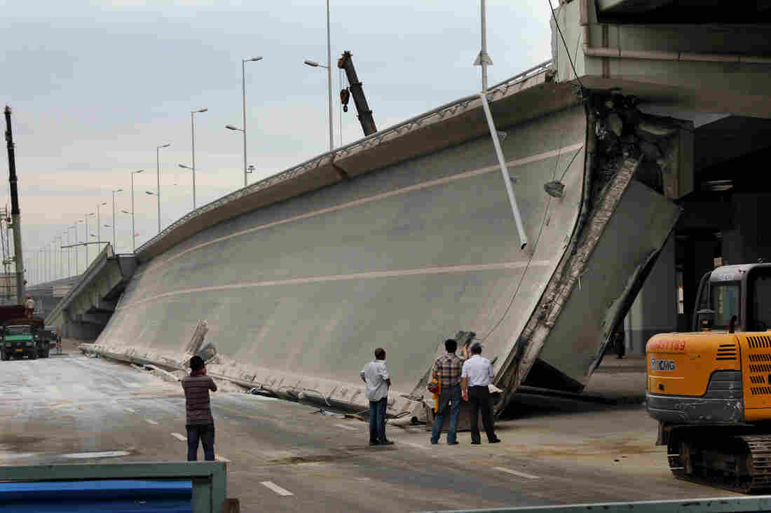 Eight bridges have collapsed around China since 2011. Here, government investigators examine a recently built entrance ramp that collapsed last week in the northeastern city of Harbin, killing three people. Local residents believe government corruption and substandard materials are to blame.