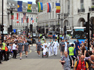 A team of torchbearers brings the Paralympic flame through Piccadilly Circus as the torch heads across London to the Olympic Stadium. The Paralympic Games' opening ceremony will be held Wednesday at 3:30 p.m. ET.