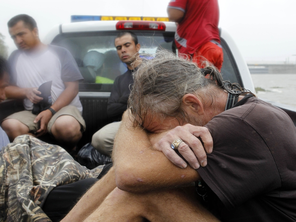 Residents who were rescued from their flooded homes are transported to waiting assistance, after Hurricane Isaac made landfall and flooded homes with 10 feet of water in Braithwaite, La. Isaac was downgraded to a tropical storm Wednesday afternoon. (AP)