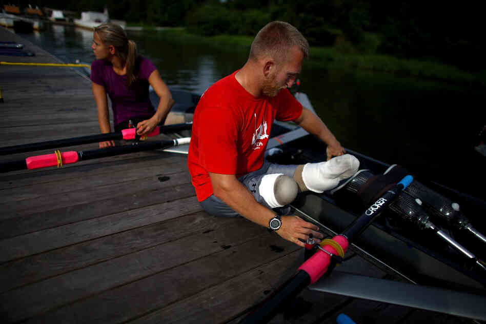 U.S. rowers Rob Jones and Oksana Masters train at the Rivanna Reservoir in Charlottesville, Va. The pair will compete in adaptive rowing at the London Paralympics this week. Jones, a former U.S. Marine, lost both legs to an improvised land mine in southern Afghanistan.