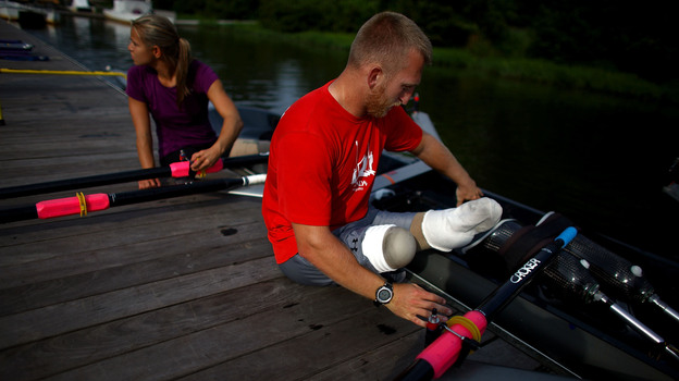 U.S. rowers Rob Jones and Oksana Masters train at the Rivanna Reservoir in Charlottesville, Va. The pair will compete in adaptive rowing at the London Paralympics this week. Jones, a former U.S. Marine, lost both legs to an improvised land mine in southern Afghanistan.  (NPR)